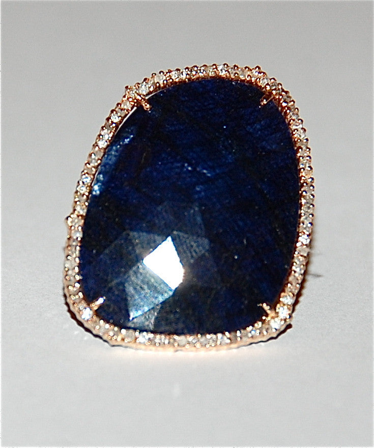 Sapphire with pave diamond ring