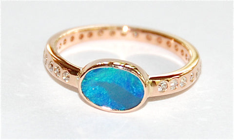 Blue green opal with paved band ring