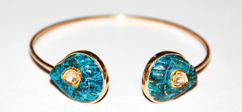 Turquoise fan shell with grand polki diamond cuff
