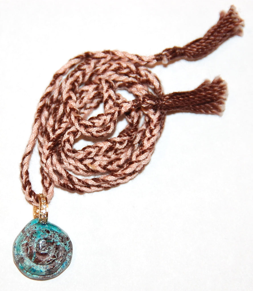 Shell pendant paved diamond rondell with hand woven cord