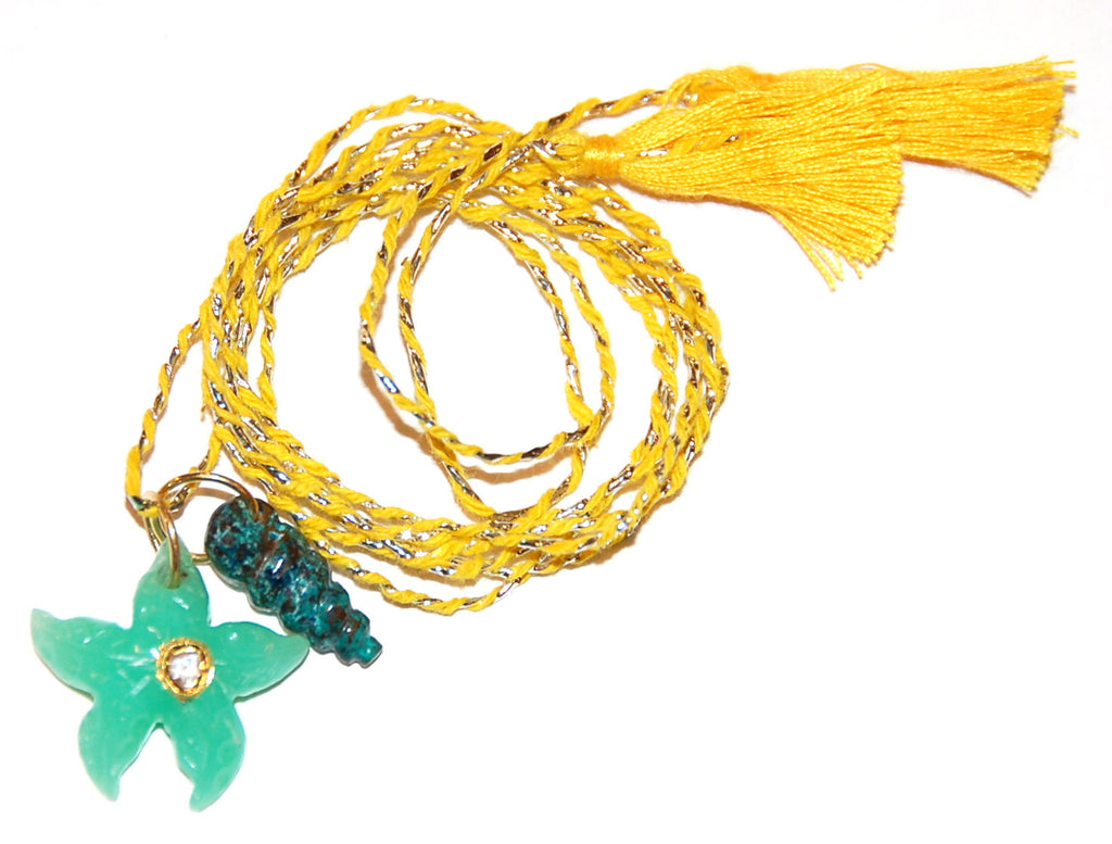 Chrysoprase sea star with polki diamond and plain twist shell on hand woven cord
