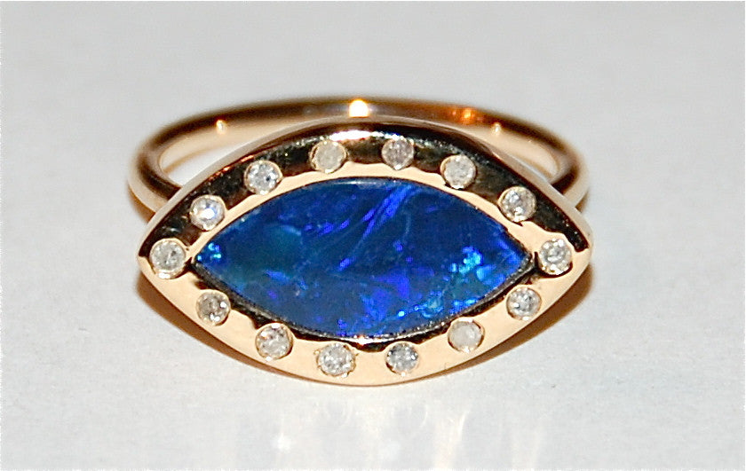 Opal with flush diamond ring
