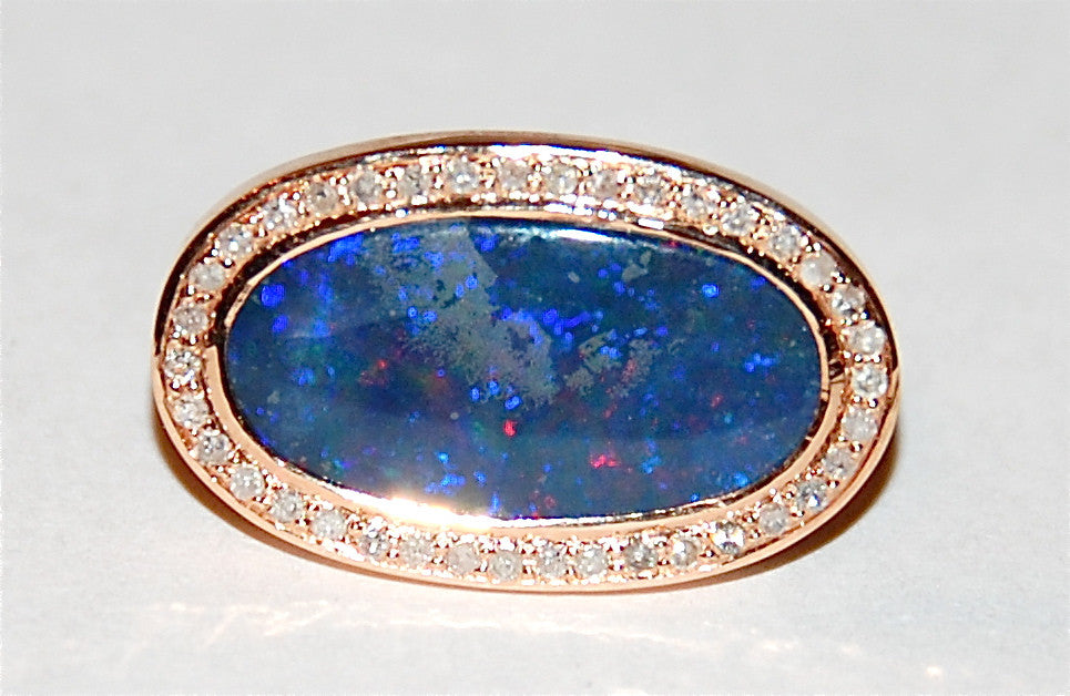 Opal with paved diamond ring