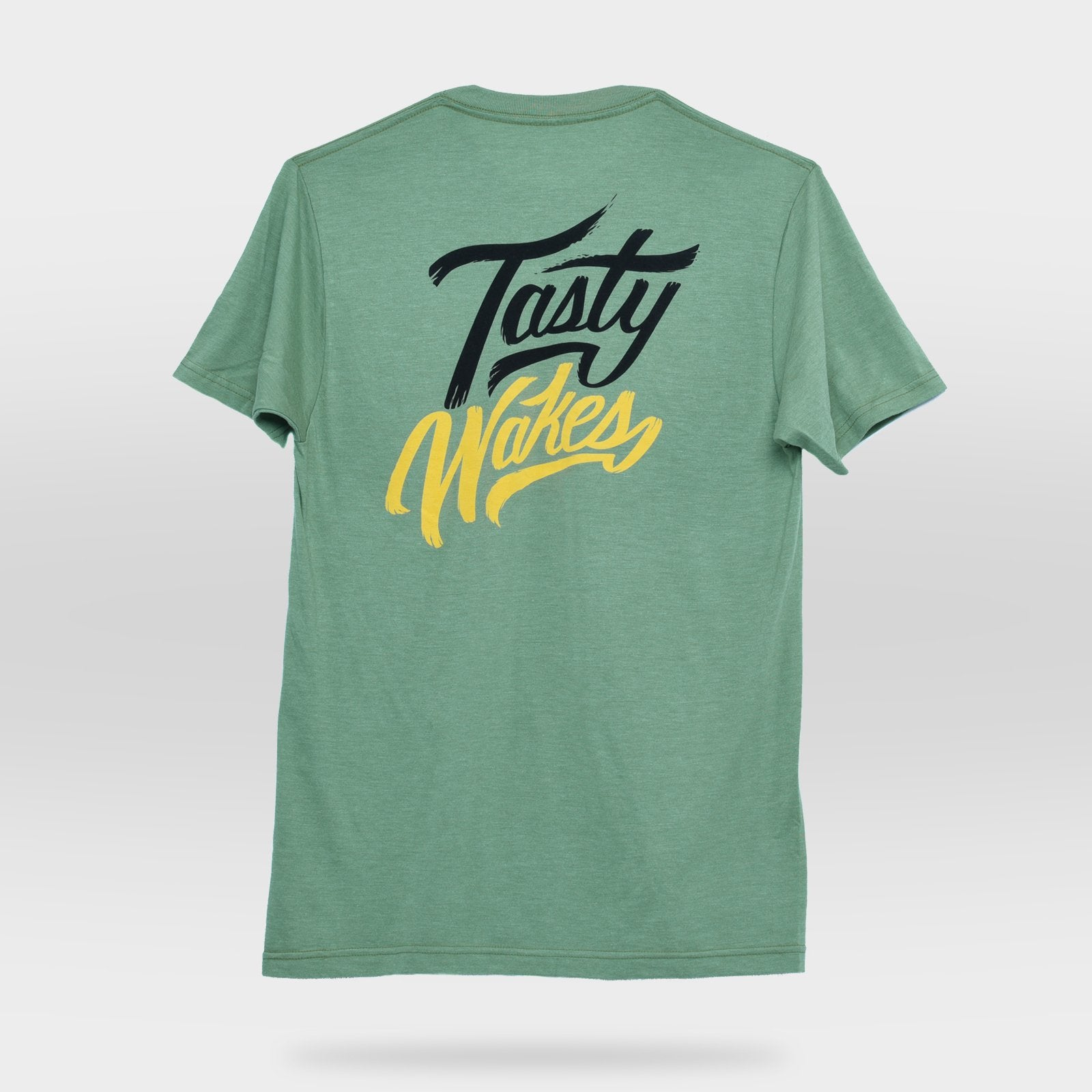 Back view of Green Tasty Wakes T-shirt on gray background