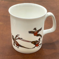 1 x Bone china shooting mug. Catapulting pheasants by Bryn Parry