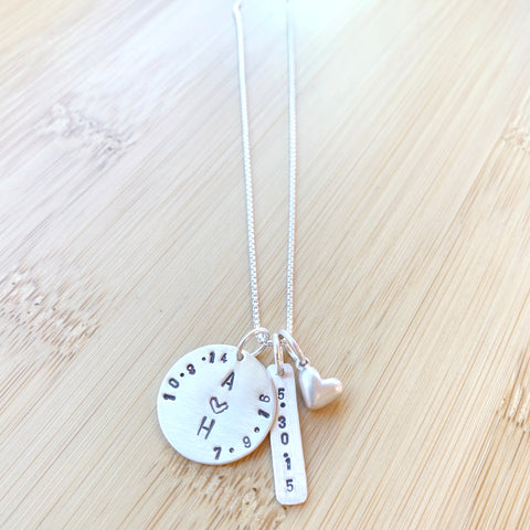 Custom stamped necklace with dates and initals