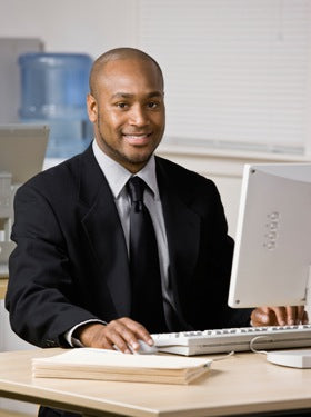 Well-dressed man at computer