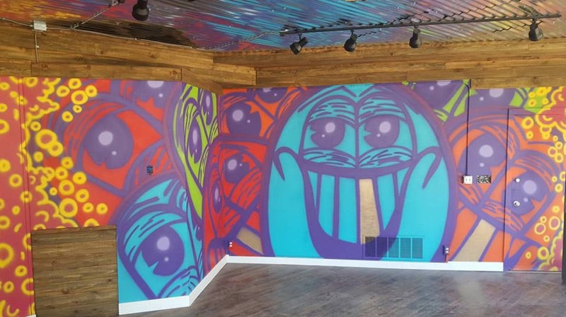 Skyblue Artist Ethan Rivelle Creates Motion Boardshop Mural