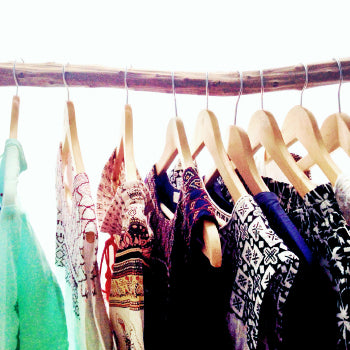 some dresses on coat-hangers