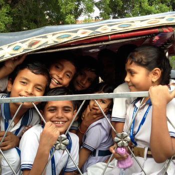 some indians children smiling