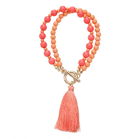 beaded tassel bracelet in peach is the perfect summer accessory