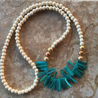 Beaded teal fringe necklace adds color to your outfit for spring and summer 2016