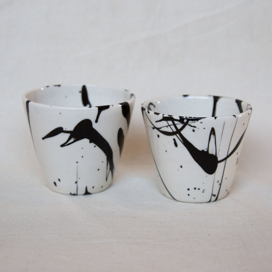 BTW black and white splattered cups