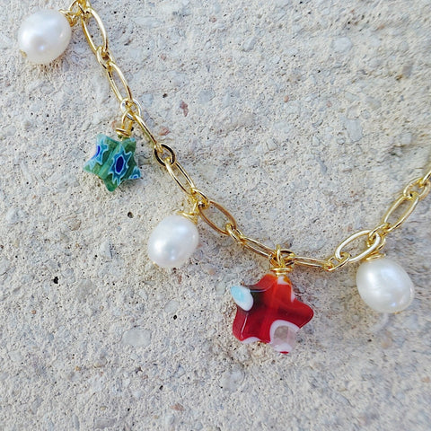 gold plated necklace with glass star and pearl charms, dangling choker necklace