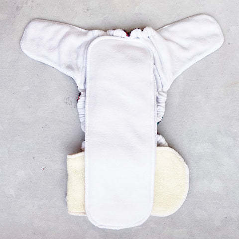 cloth diaper t hack for tummy sleeping babies front leaks