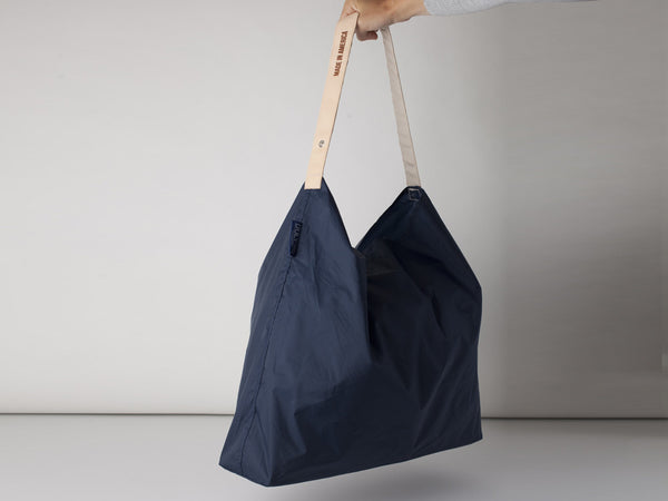 Shopping bag with a difference. Leather strap, roll up tote bag. Nylon
