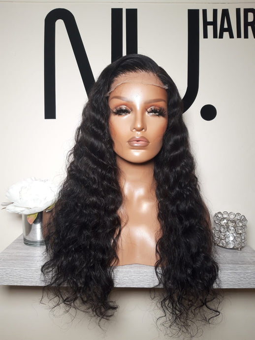 Natural curly lace closure wig on mannequin
