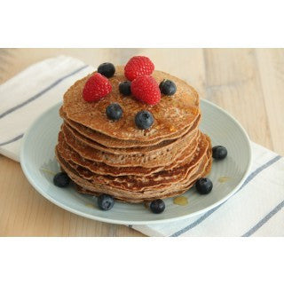 Sweet pancakes with red berries