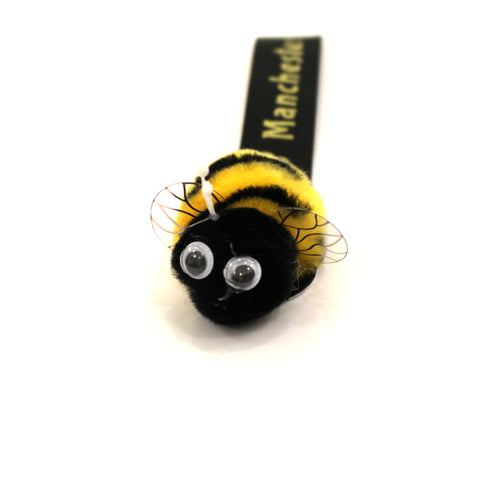 Fuzzy stick on bee with Manchester label