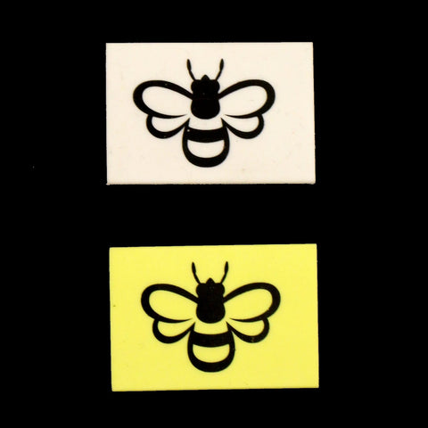 Yellow or White eraser featuring black outline of a bee