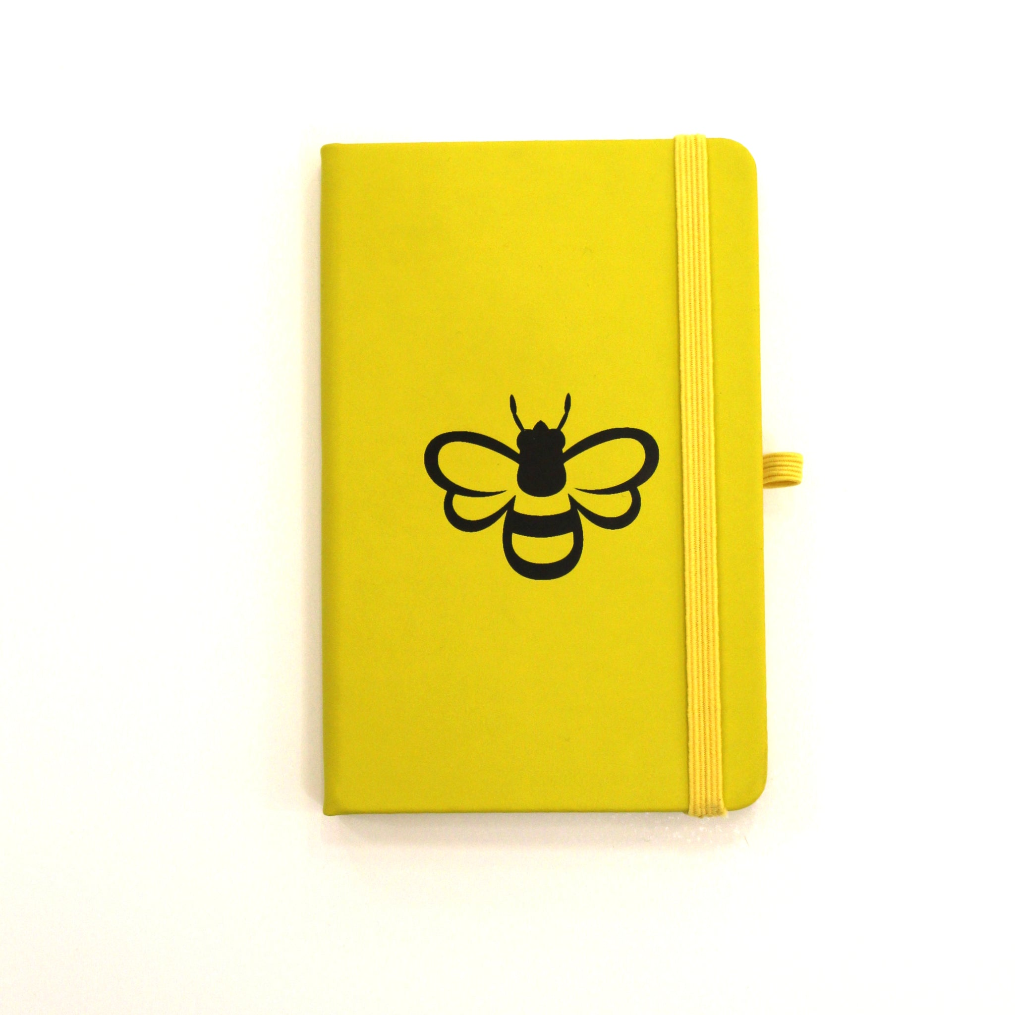 Yellow notebook with black bee outline.