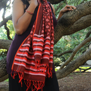 Rust red cotton Ikat stole with allover diamond motifs with bright orange edge piping