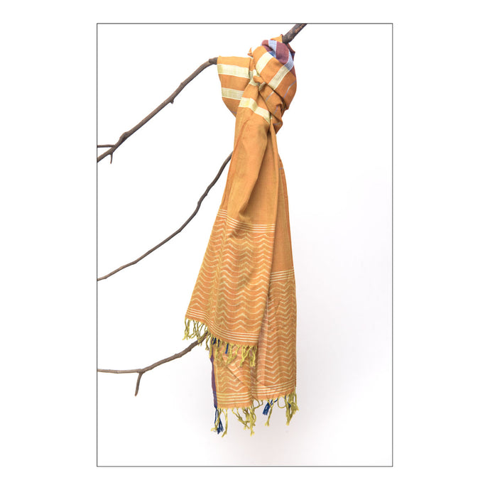 Sambalpuri orange cotton ikat stole with wave motifs on both ends.