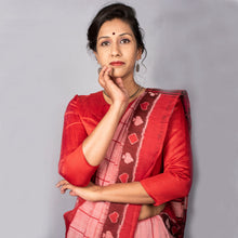 Handwoven pink, red and black ikat saree with taash border and bright red edges