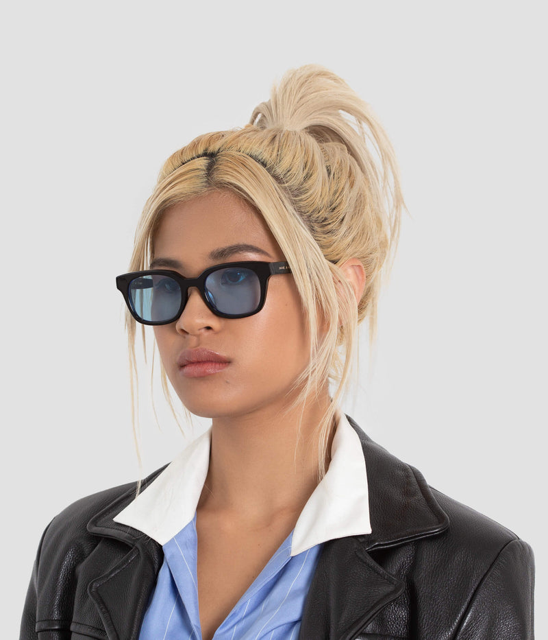 Female model wearing Chess Club Tian Blue Sunglasses