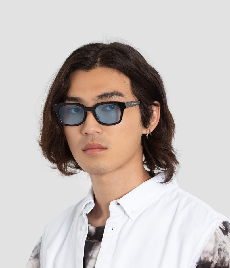 Male model wearing Chess Club Tian Blue Sunglasses