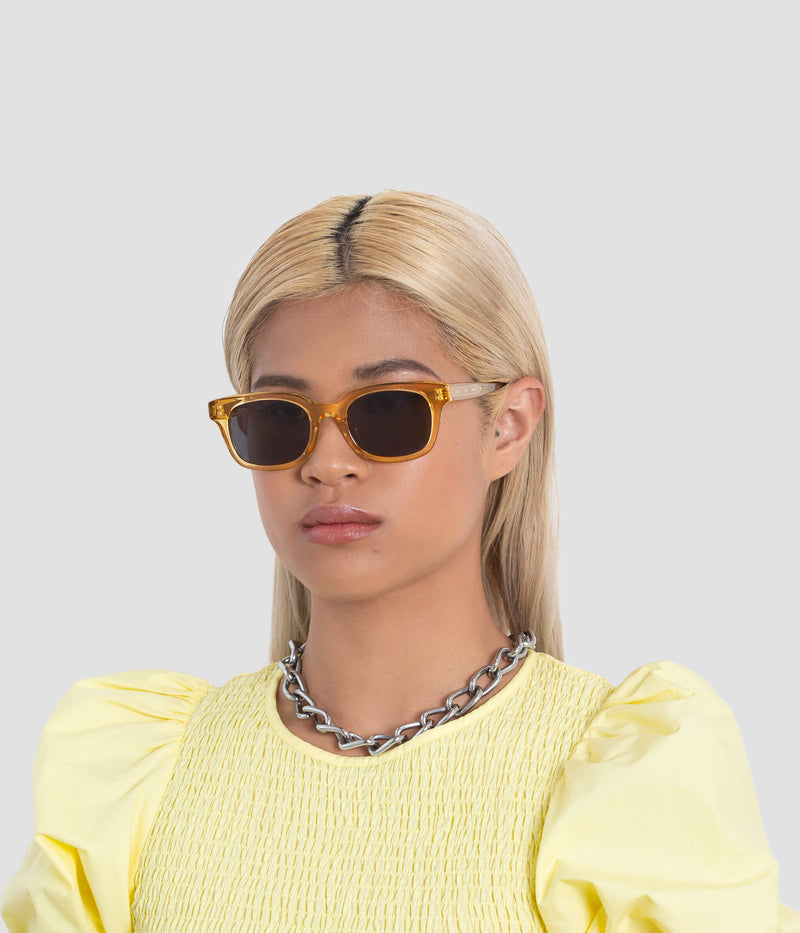 Female model wearing Chess Club Blond Black Sunglasses