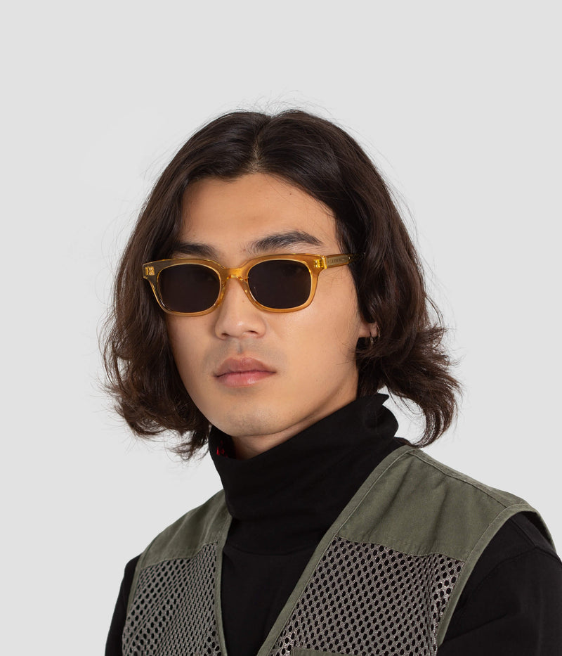 Male model wearing Chess Club Blond Black Sunglasses