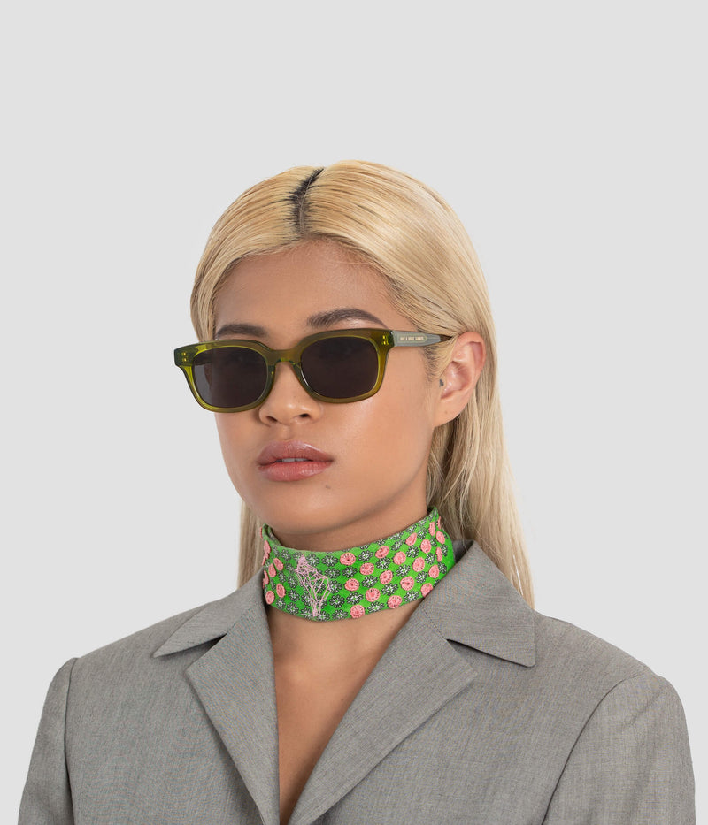 Female model wearing Chess Club Moss Black Sunglasses