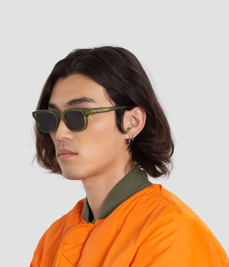 Male model wearing Chess Club Moss Black Sunglasses