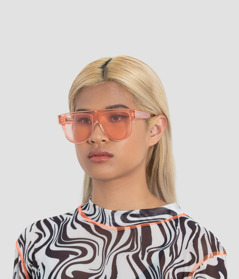 Female Model wearing Continuum Coral Sunglasses