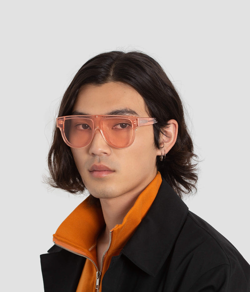 Male Model wearing Continuum Coral Sunglasses