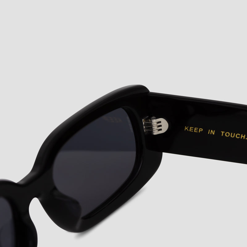 Detail shot of Show and Tell Black-Black Sunglasses
