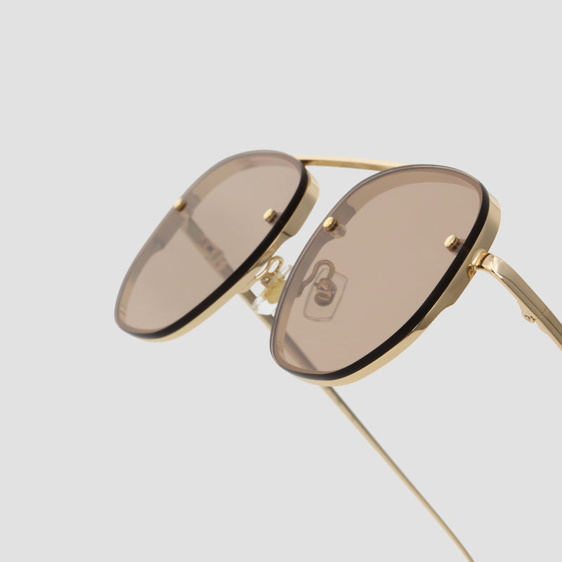 Detail shot of Traction Japanese Gold-Almond Sunglasses