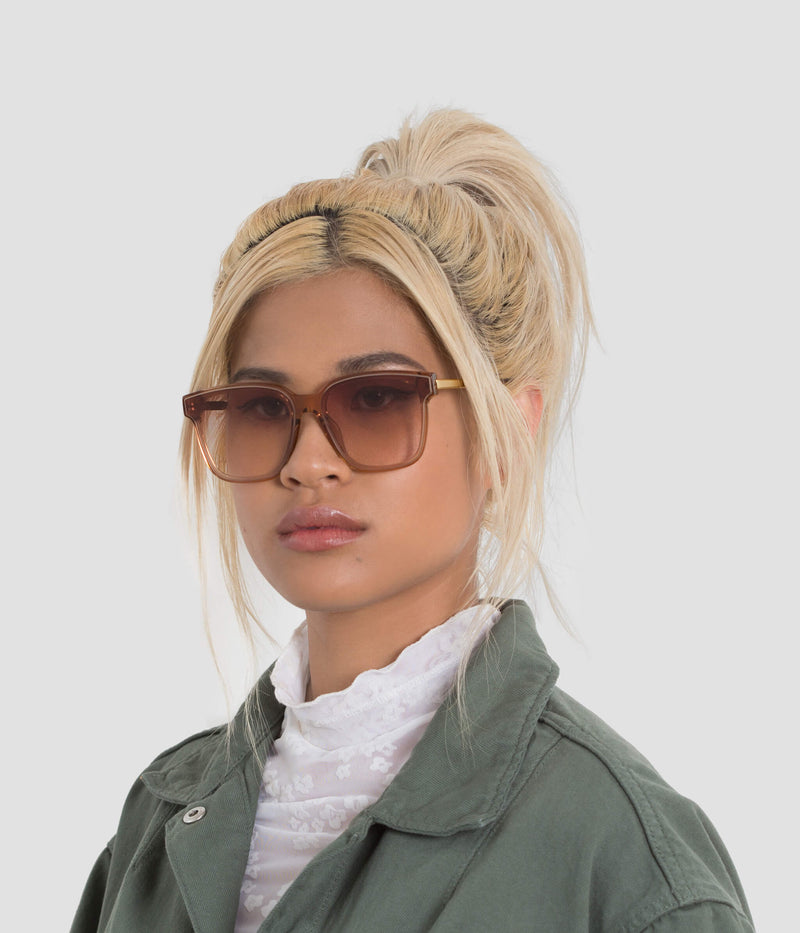Female Model wearing Wall Almond Sunglasses