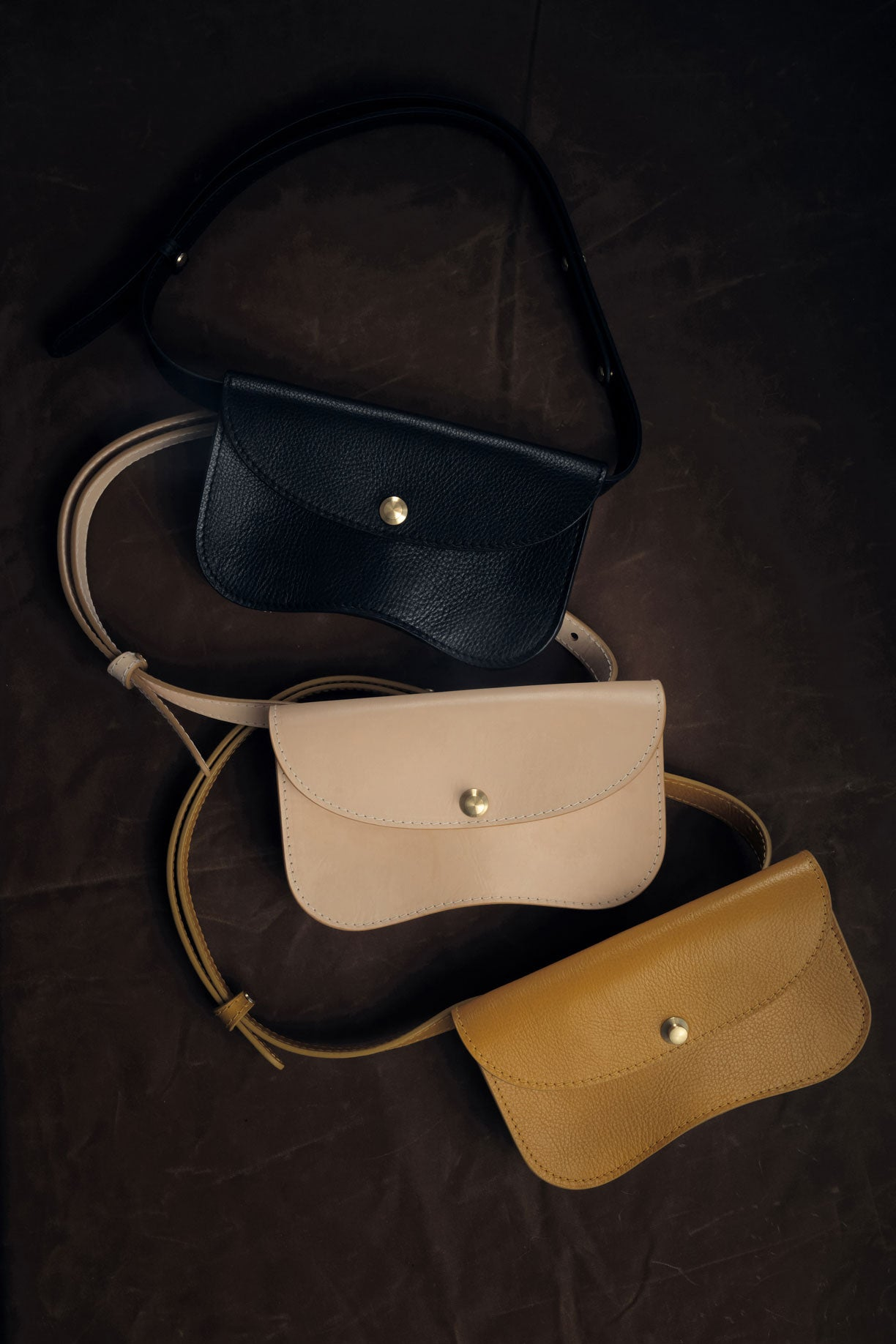 Faba sling style leather bag