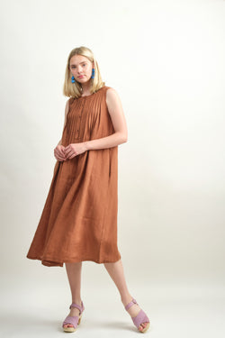 7115 by Szeki Pleated Midi Dress