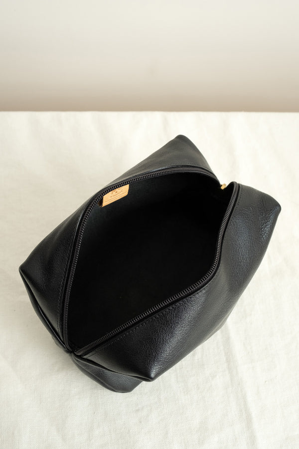 Simple black leather toiletries case