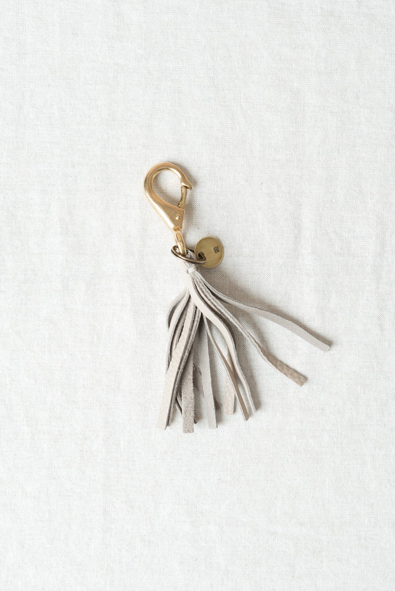 Leather tassel keychain in putty