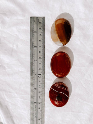 Carnelian Pillow Palm Stone - Unearthed Crystals