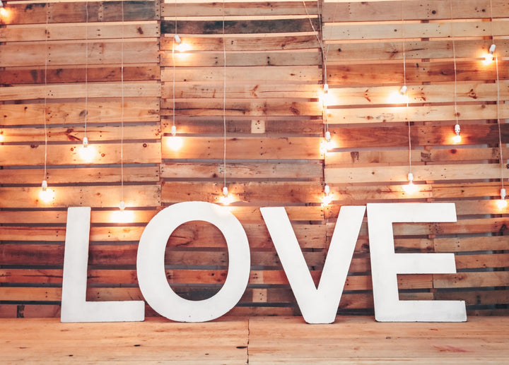 Old-fashioned love with wood wall.