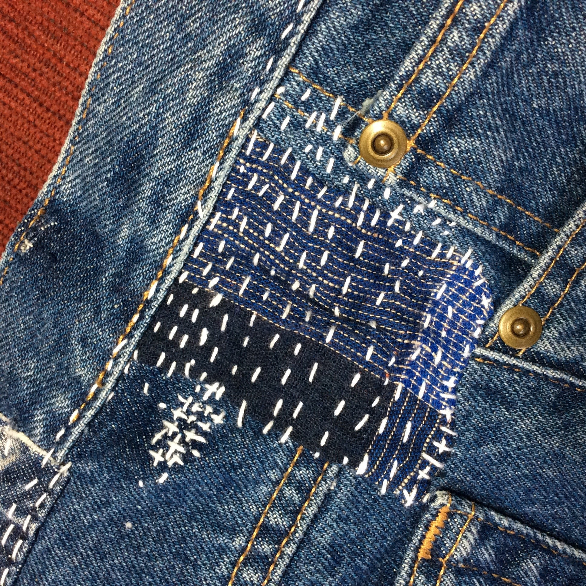 boro sashiko mending on blue jeans