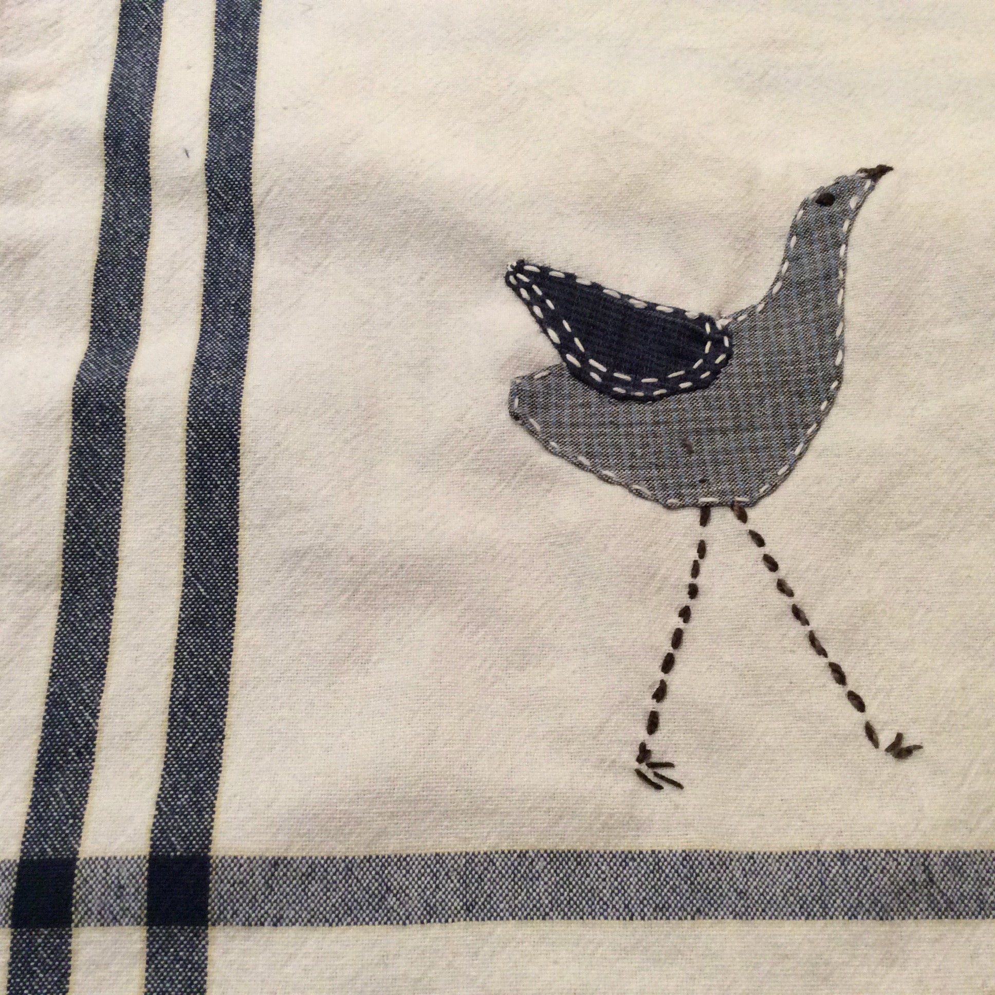 bird applique and stitching
