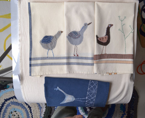kitche tea towels stitched with whimsical birds