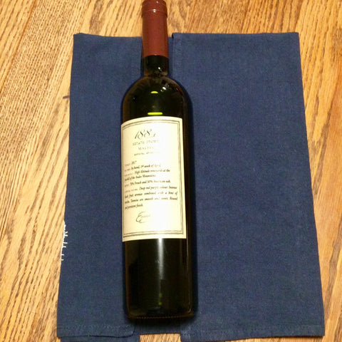 wrapping a wine bottle with tea towel for gifting
