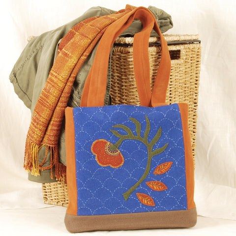 Sashiko stitched background on wool applique bag
